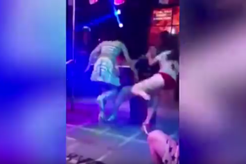 Watch This Angry Girlfriend Push A Stripper And Drag Her Man Away From Lap Dance