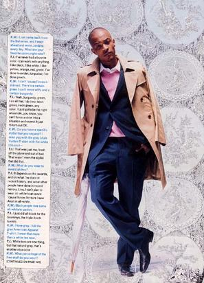 TI in Complex Rocking a pink sweater under a suit and a trench coat