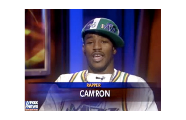 Cam'ron wearing a Utah Jazz throwback and fitted