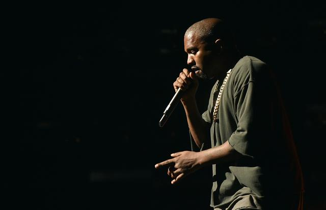 Kanye West performs onstage at the 2015 iHeartRadio Music
