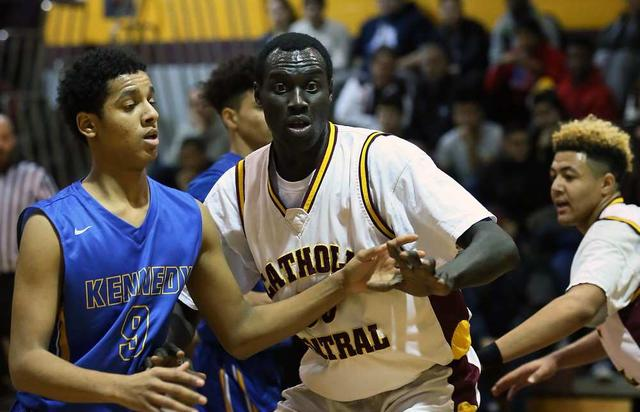 atholic Central Comets Jonathan Nicola, centre, defends against Kennedy Clippers Omer Sulliman, left, in senior boys' basketball action at Catholic Central on Jan. 5, 2016.