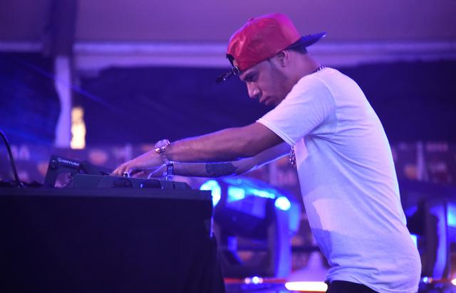 Araabmuzik performs on stage