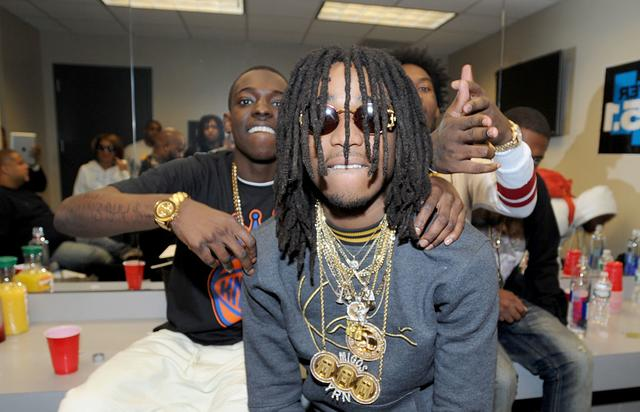 (L-R) Rapper Bobby Shmurda and rappers Quavo and Offset of Migos pose backstage at Power 105.1's Powerhouse 2014 at Barclays Center of Brooklyn on October 30, 2014 in New York City.