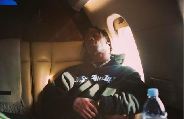 Travis Scott sleeps on the plane.