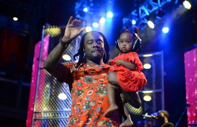 Wale performs onstage with his daughter