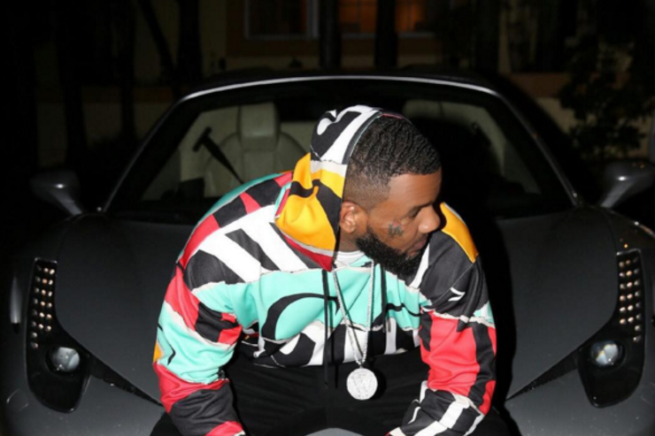 Game sitting on luxury car