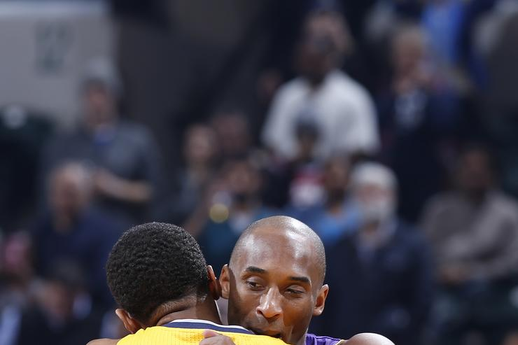 Kobe Bryant and Paul George during the game.