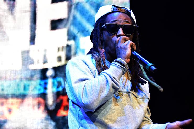 Lil Wayne performs at The Conglomerate And Hot 97 Present 'Busta Rhymes And Friends: Hot For The Holiday' show at Prudential Center