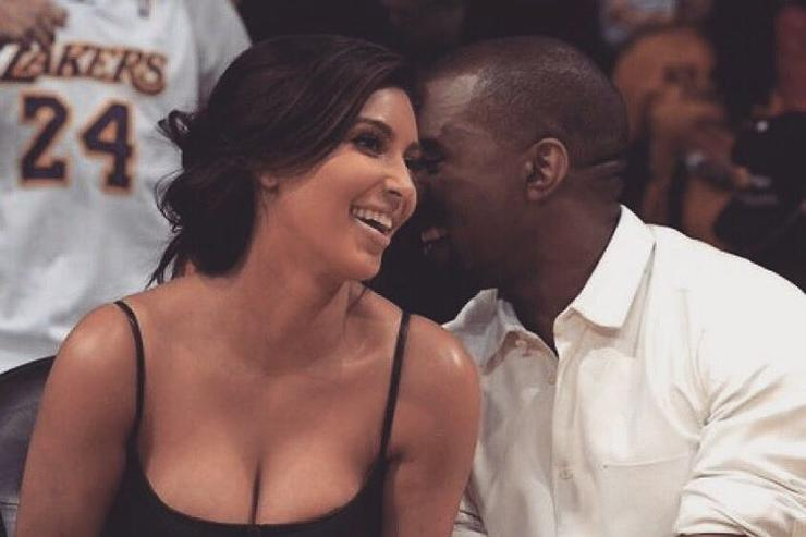 Kanye West & Kim Kardashian courtside at bball game