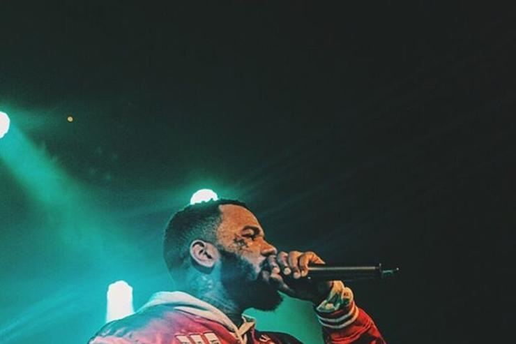 The Game performs on stage
