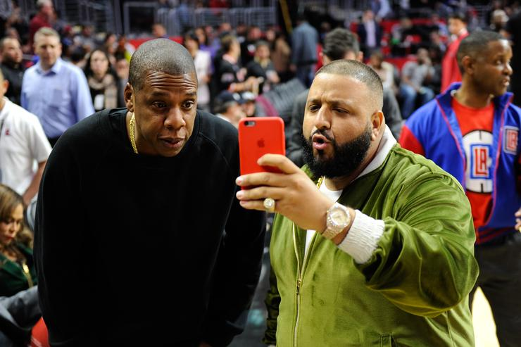 Jay-Z (L) and DJ Khaled attend a basketball game between the Miami Heat and the Los Angeles Clippers at Staples Center