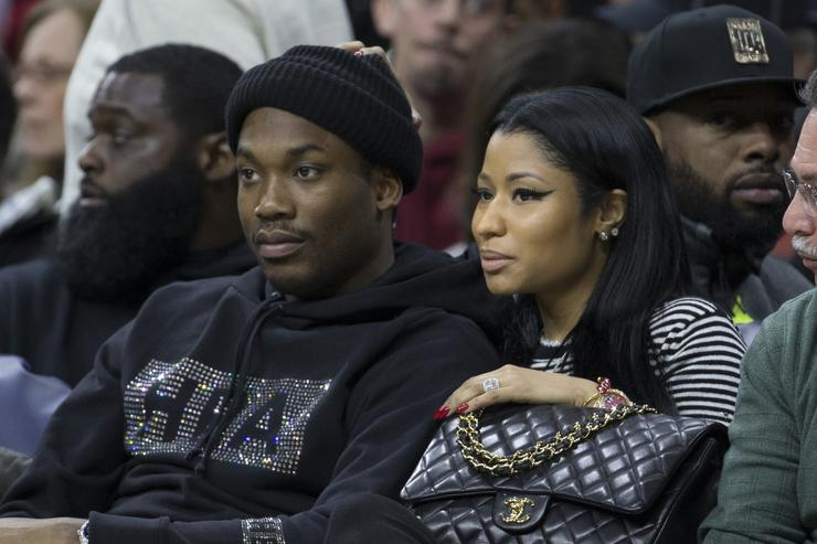 Musical artists Meek Mill and Nicki Minaj watch the game between the Golden State Warriors and Philadelphia 76ers on January 30, 2016 at the Wells Fargo Center in Philadelphia, Pennsylvania. The Warriors defeated the 76ers 108-105.