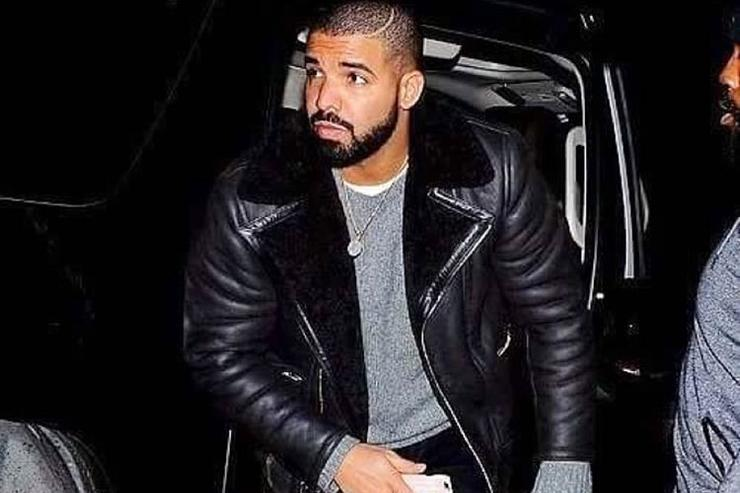 Drake coming out of a car