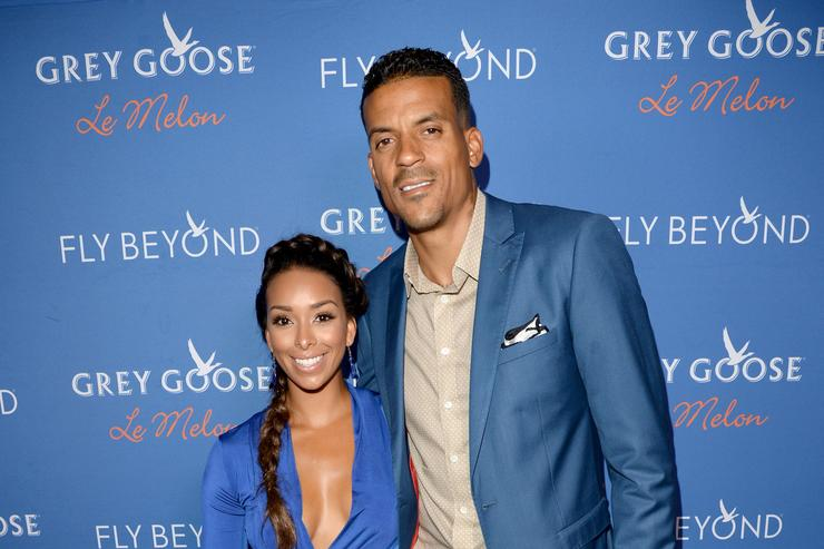 Professional basketball player Matt Barnes (R) and Gloria Govan at Carmelo Anthony Kehinde Wiley Dinner Hosted by GREY GOOSE at Sunset Tower on July 15, 2014 in West Hollywood, California.