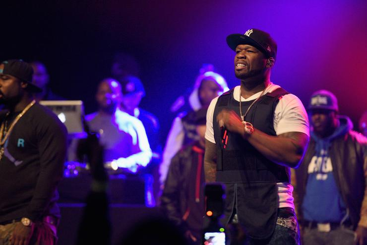 50 Cent performing with a bulletproof vest on