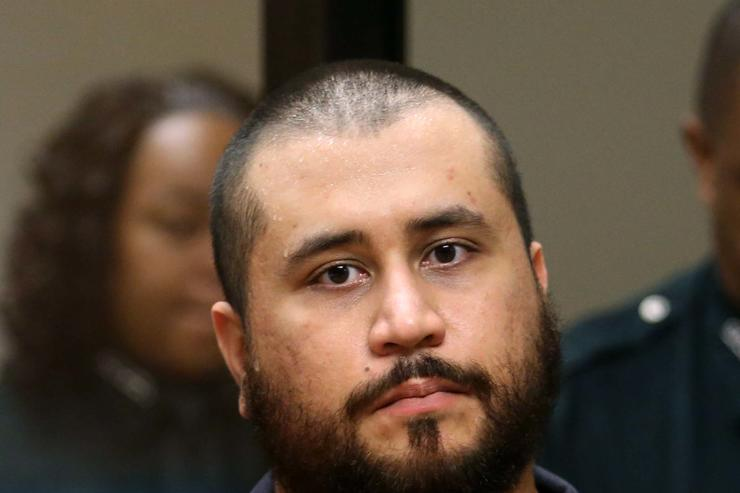 George Zimmerman, the acquitted shooter in the death of Trayvon Martin, faces a Seminole circuit judge during a first-appearance hearing on charges including aggravated assault stemming from a fight with his girlfriend November 19, 2013 in Sanford, Florida. Zimmerman, 30, was arrested after police responded to a domestic disturbance call at a house. He was acquitted in July of all charges in the shooting death of unarmed, black teenager, Trayvon Martin.