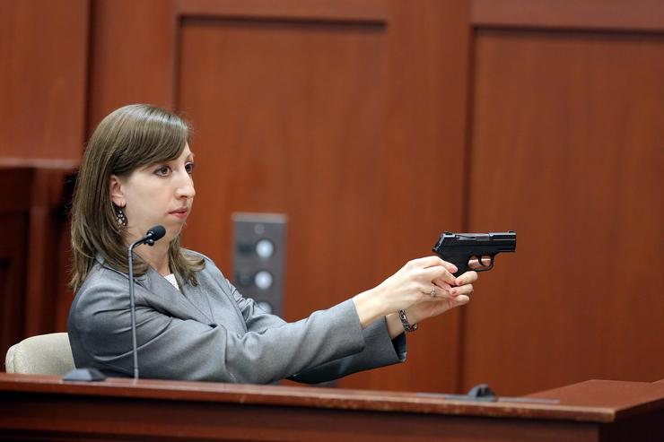 ent shows the jury how George Zimmerman's gun can be fired during the George Zimmerman trial in Seminole circuit court, July 3, 2013 in Sanford, Florida. Zimmerman is charged with second-degree murder for the February 2012 shooting death of 17-year-old Trayvon Martin.