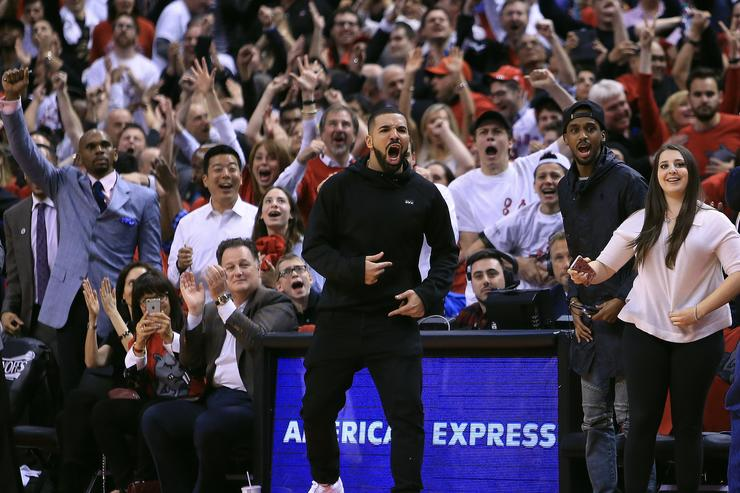 TORONTO, ON - APRIL 26: Singer Drake celebrates after Terrance Ross #31 of the Toronto Raptors sinks a 3-pointer in the second half of Game Five of the Eastern Conference Quarterfinals against the Indiana Pacers during the 2016 NBA Playoffs at the Air Canada Centre on April 26, 2016 in Toronto, Ontario, Canada.
