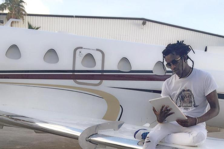 Young Thug sitting on a plane