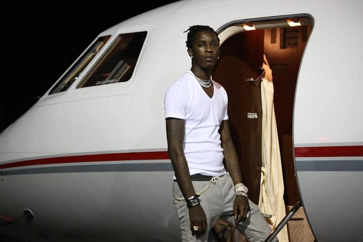 Young Thug outside his private jet.