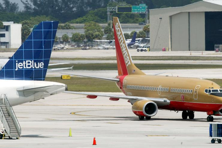 A Jetblue and Southwest jets sit on the tarmac at Fort Lauderdale Internatational Airport May 21, 2004 in Fort Lauderdale, Florida. Low-cost airlines now account for about 20 percent to 25 percent of the market and in the U.S., that figure is predicted to rise to more than 40 percent within a few years.