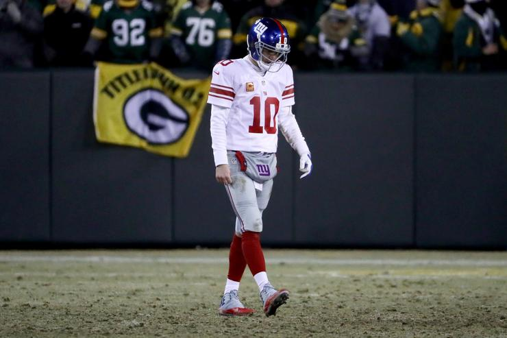 Eli Manning #10 of the New York Giants walks off the field in the fourth quarter during the NFC Wild Card game against the Green Bay Packers at Lambeau Field on January 8, 2017 in Green Bay, Wisconsin.