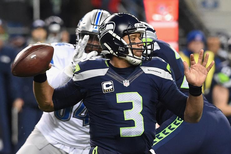 Russell Wilson #3 of the Seattle Seahawks looks to pass the ball during the first half against the Detroit Lions in the NFC Wild Card game at CenturyLink Field on January 7, 2017 in Seattle, Washington.
