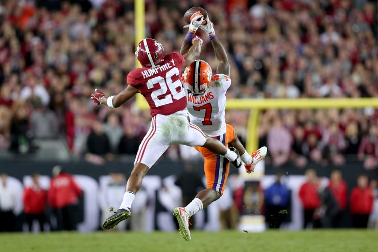 Wide receiver Mike Williams #7 of the Clemson Tigers makes a reception against defensive back Marlon Humphrey #26 of the Alabama Crimson Tide during the fourth quarter of the 2017 College Football Playoff National Championship Game at Raymond James Stadium on January 9, 2017 in Tampa, Florida.