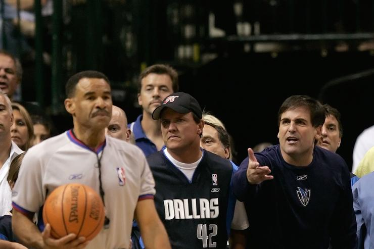 Owner Mark Cuban of the Dallas Mavericks, far right, reacts to a call as referee Dan Crawford holds the ball near the baseline in game six of the 2006 NBA Finals against the Miami Heat on June 20, 2006 at American Airlines Center in Dallas, Texas.