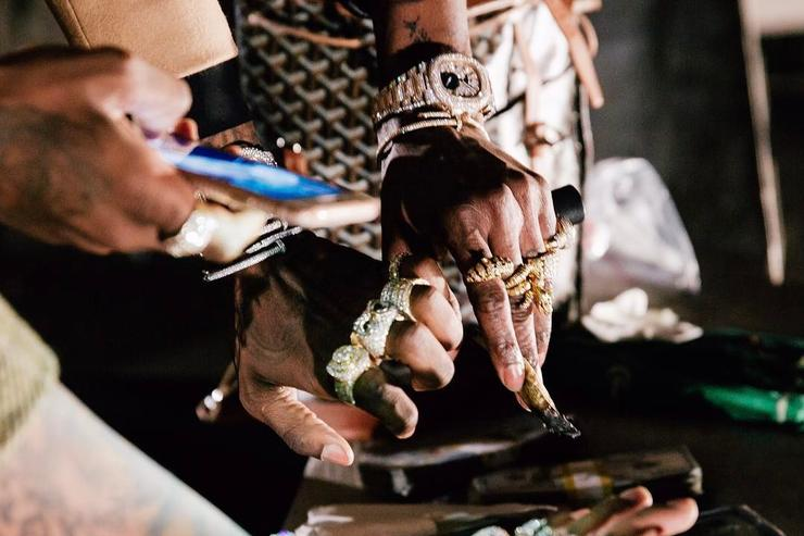 "jewelry from Migos' ""deadz"" video shoot"