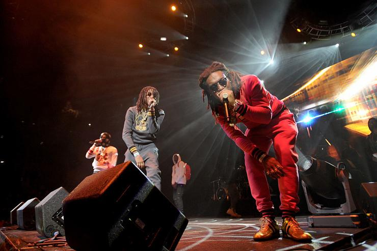 Rappers Takeoff, Quavo, and Offset of Migos perform on stage at Power 105.1's Powerhouse 2014 at Barclays Center of Brooklyn on October 30, 2014 in New York City.