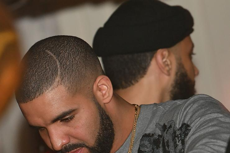 drake pouring a drink