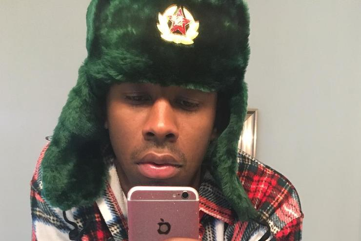 Tyler The Creator taking a mirror selfie