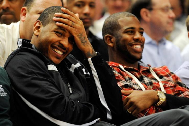 Melo + CP3 courtside at 2011 State Farm Champions Classic